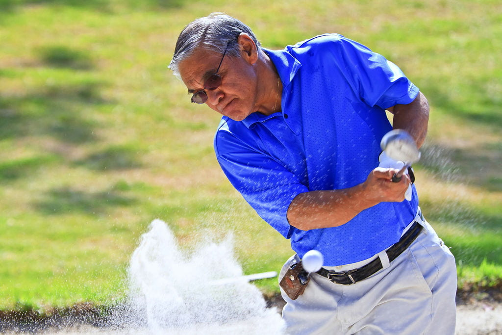 Rey Buack golfing
