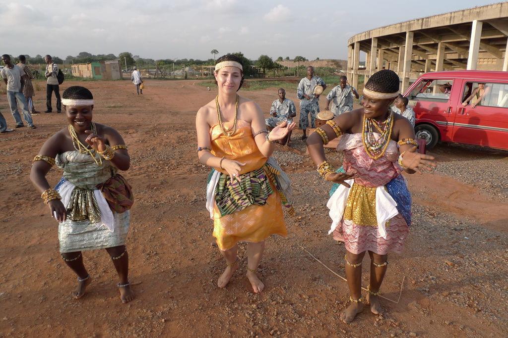Jenna Tatone performs Adowa, a royal dance of the Ashanti people, with Ghana Dance Ensemble dancers