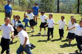Payam Falatoonzadeh and Hope Velarde play with students at El Junco Elementary School