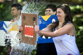 Camille LaFleur stops a water balloon with a wooden shield