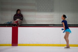 Zhou's mother watching her skate