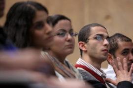 Mamdouh Hanna listens to a guest speaker