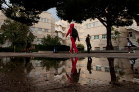 A student walks past the School of Social Sciences