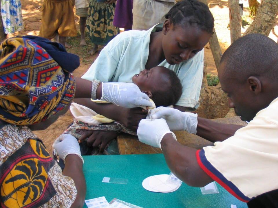 School children in Kenya having their blood sampled for malaria parasites.