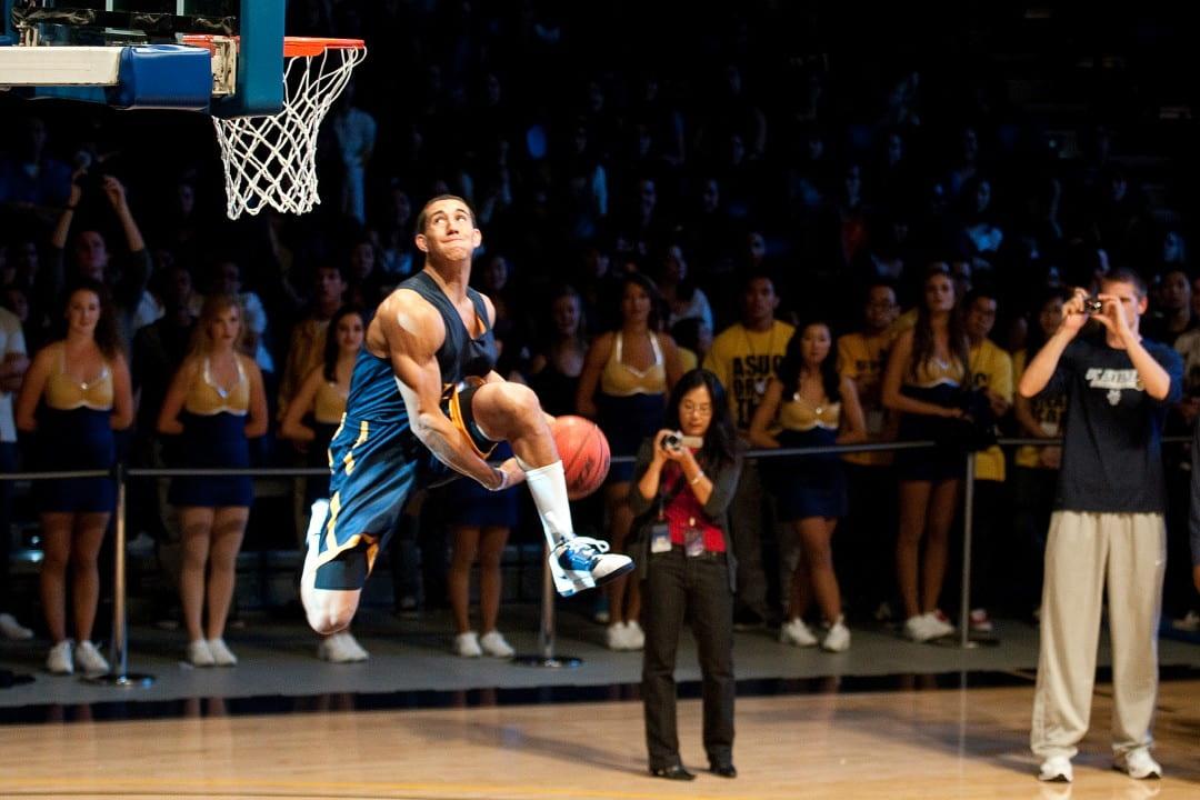 Daman Starring attempts an under-the-leg slam dunk
