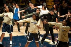 Women's basketball players join Kaba Modern in a dance performance