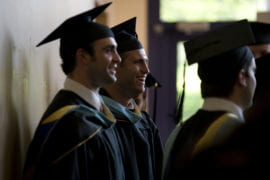 Students are all smiles as they wait for commencement to begin.