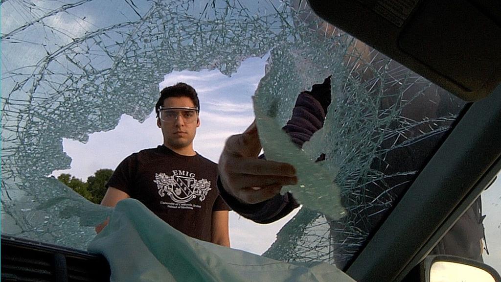 Ashkan Akasheh prepares a mangled Honda Civic