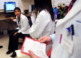 Charitha Reddy and other medical students consult about patient treatment