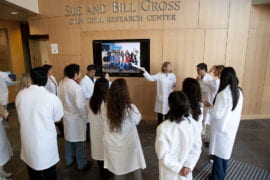 Here, CIRM fellows are briefed before leading guest tours of the new facility.