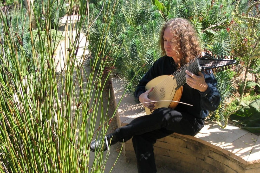 John Schneiderman, director of the guitar & lute performance program at UCI, plays the baroque lute at Gamble Gardens in Palo Alto. An upcoming concert with Oleg Timofeyev will feature music on Russian guitars, and a CD of their work will be released later this year.