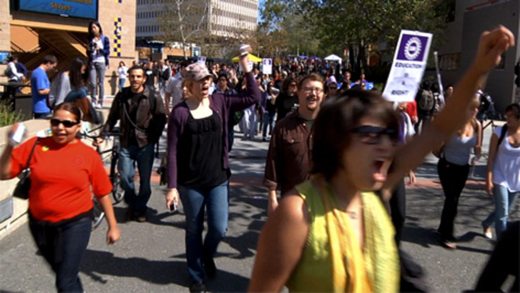 "Students protesting state budget cuts to education march on UCI's Ring Mall during March 4's ""Day of Action."""