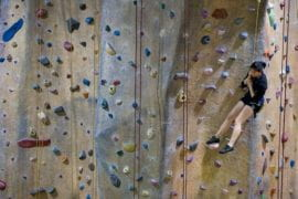 Student Stephanie Hwang catches her breath at a Rock the Wall
