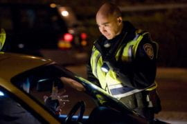 Officer Christopher Bolano chats with a motorist
