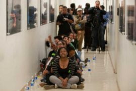 Students and labor organizers chant in a hallway of the UC Irvine administration building