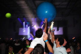Students propel giant inflated balls during the concert.
