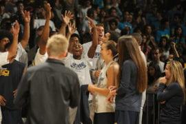 UCI men's basketball players celebrate