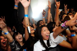 Students cheer for Gym Class Heroes