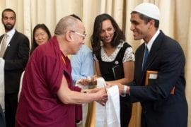 The Dalai Lama presents a white silk scarf to Dalai Lama Scholar Armaan Rowther