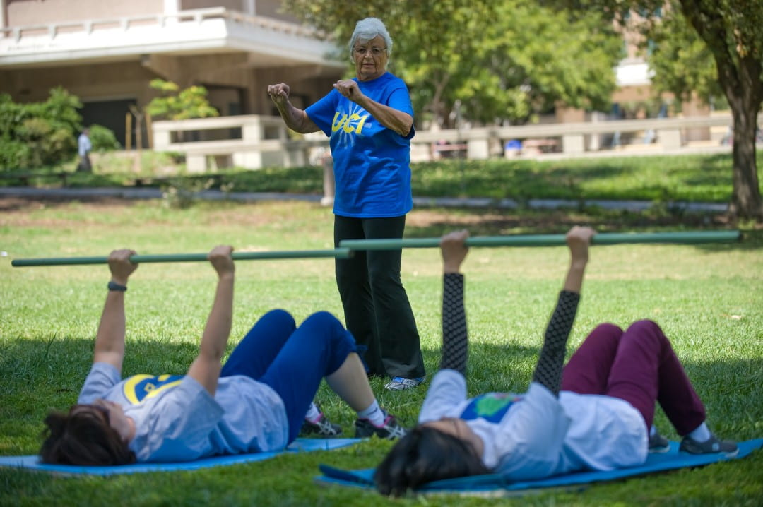 Olga Connolly leads a workout class in Aldrich Park