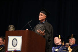 Olympic diving champion and UCI alum Greg Louganis addresses graduates