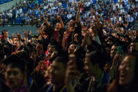 Grads cheer during commencement for the School of Social Sciences.