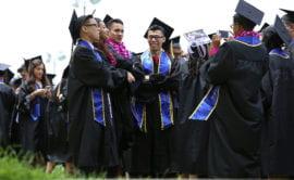 Biological sciences grads line up before commencement
