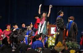 Chemistry grad Hannah Bui celebrates onstage