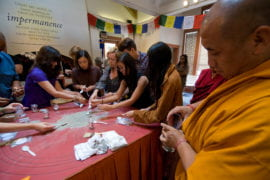 UCI students, campus officials, representatives from the Center for Living Peace, and Friends of the Dalai Lama witnessed and participated in the mandala dissolution ceremony.