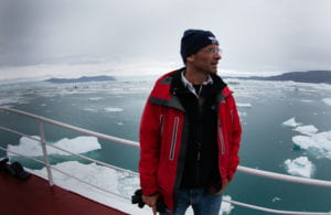 Eric Rignot, Chancellor's Professor of Earth system science at UCI, stands aboard the 294-ton Cape Race, from which he and his team measured Greenland's melting glaciers in summer of 2014. He is senior author on a new paper showing the effects of warming air and seawater on glaciers that could boost global sea level by 39 inches if they collapsed. photo: Maria Stenzel / for UCI