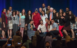 Mary Sargious, far right, poses for pictures with the XIV Dalai Lama during the Compassion Summit at UCI in July. Steve Zylius / UCI