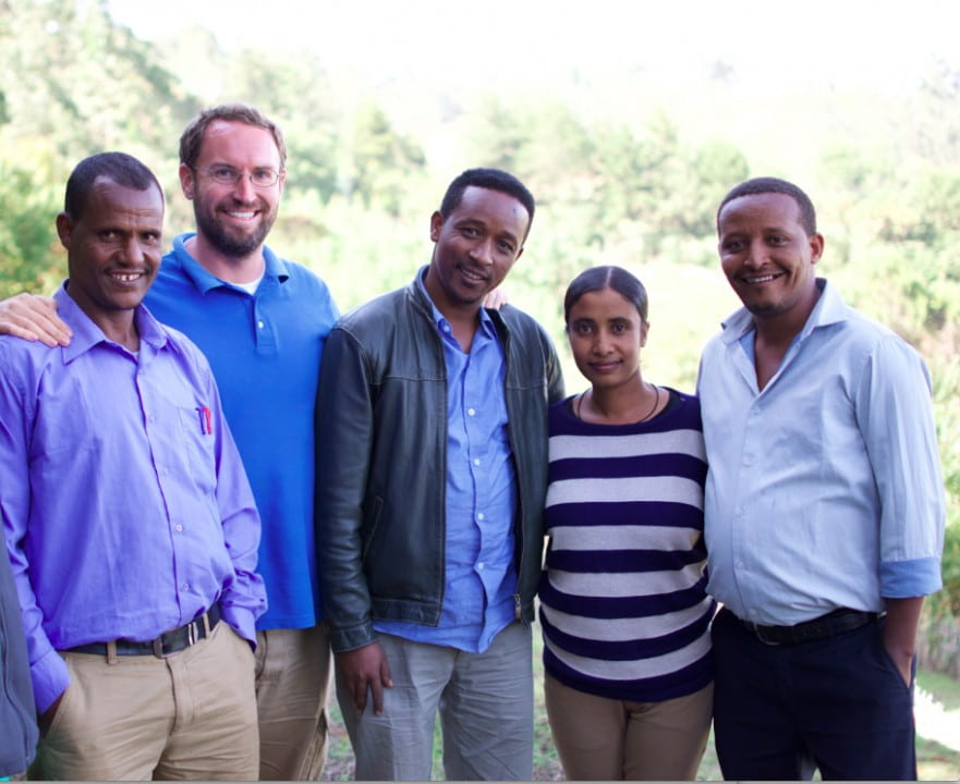 """People in the education field often get caught up in technology. But when you go into a school with no electricity, no books and dirt floors, you realize maybe the best option isn't giving every kid a laptop,"" says Jimmy Leak '12 (second from left), flanked by Nuru International Ethiopian team members.  Courtesy of Jimmy Leak"