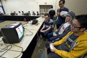 Super Smash Bros. players (from left) Griffin Williams, Benjamin Tolan and Jason Chen hone their skills at the UCI Student Center during their weekly meeting. The campus has a community of dedicated gamers. Steve Zylius / UCI
