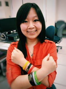 Recent computer game science grad Kathy Chiang, who helped shape the UCI eSports initiative, shows off her rubber gaming bracelets. Tonya Becerra / UCI
