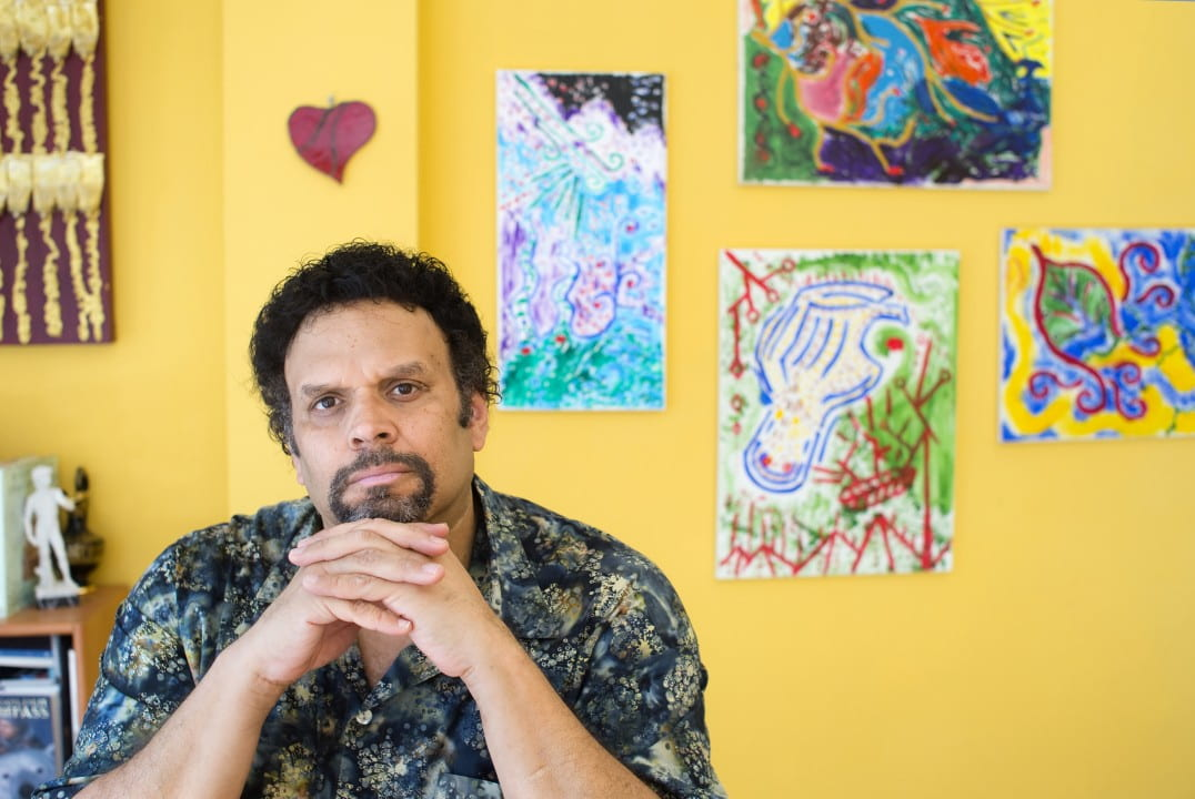 UCI alumnus Neal Shusterman's most recent novel, Challenger Deep , won a 2015 National Book Award for Young People's Literature. Some of the artwork behind him was created by his son Brendan during psychotic episodes.  Steve Zylius / UCI