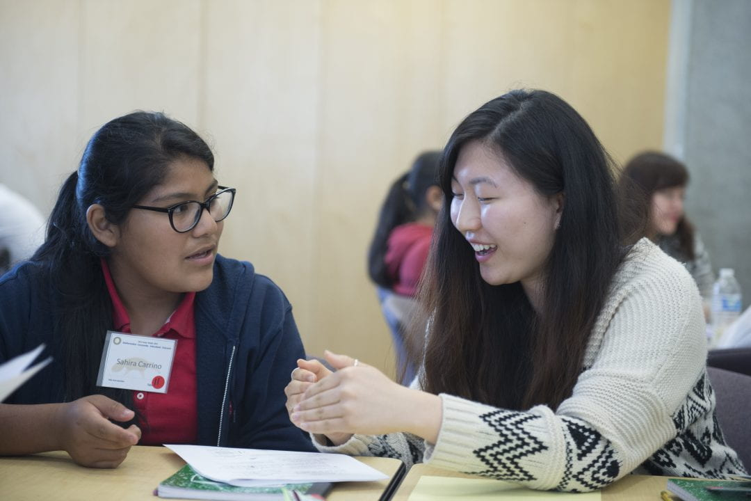 UCI junior Christine Nam helps Sahira Carrino, a sixth-grader at Santa Ana's Villa Fundamental Intermediate School, during a Math CEO session.  Chris Nugent / UCI