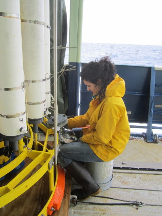 Alysha Coppola on the deck of the National Oceanographic and Atmospheric Administration research vessel Ronald Brown collecting seawater samples in search of black carbon in the North Atlantic Ocean. Samples were obtained from various depths down to 2,200 meters. Sample bottles were then frozen in the ship's laboratory and transported back to UCI for further black carbon radiocarbon analysis.   Samuel Billheimer