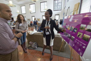 Third-year biological sciences major Lydia Natoolo gives a presentation about the Love a Community organization at the Global Food Summit. Steve Zylius / UCI