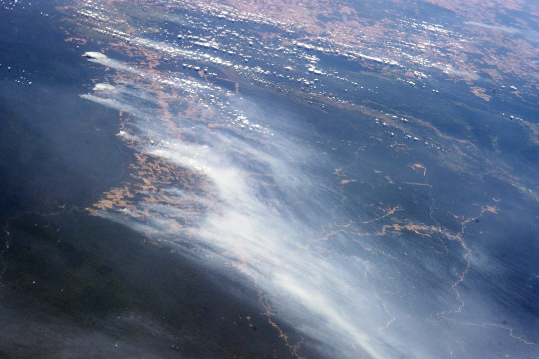The smoke from multiple fires in the Mato Grosso region of Brazil rises over forested and deforested areas in this astronaut photograph taken from the International Space Station on August 19, 2014.  International Space Station