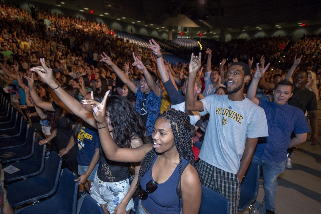 """Newly minted UCI Anteaters from the incoming class practice their """"Zot!"""" cheer – the spirit sign of the campus mascot – at New Student Convocation in fall 2015.  Steve Zylius / UCI"""
