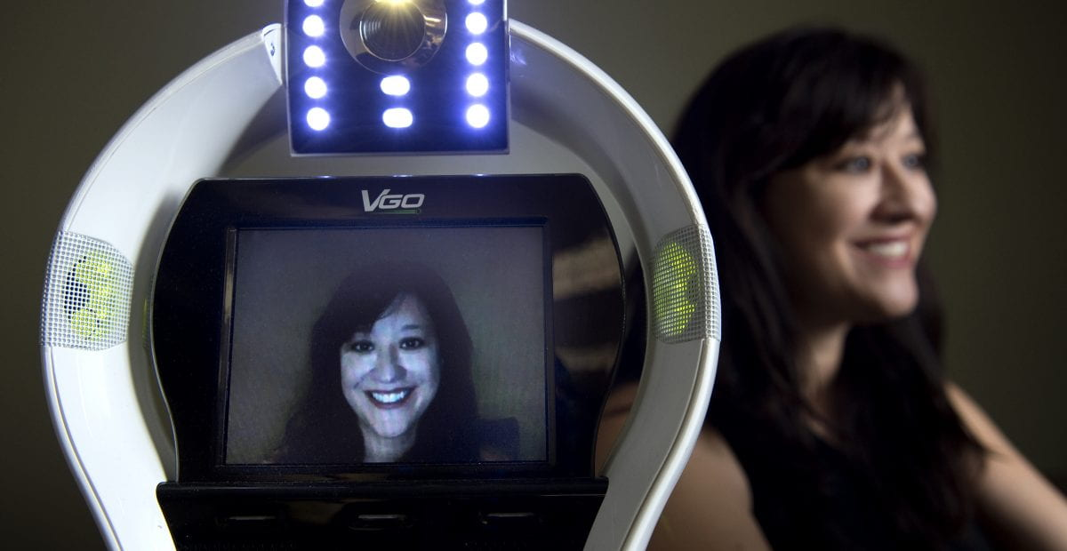 """""""Every year, large numbers of K-12 students are not able to go to school due to illness, which has negative academic, social and medical consequences,"""" says UCI doctoral student Veronica Newhart, lead author of a study on the benefits of telepresence robots, such as the one shown.  Steve Zylius / UCI"""