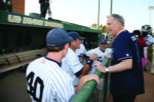 Ralph Cicerone mingles with UCI baseball players on May 19, 2009, during the dedication of Cicerone Field, named after the driving force who helped reinstate baseball in 2002 and once played varsity himself at MIT. UCI archives