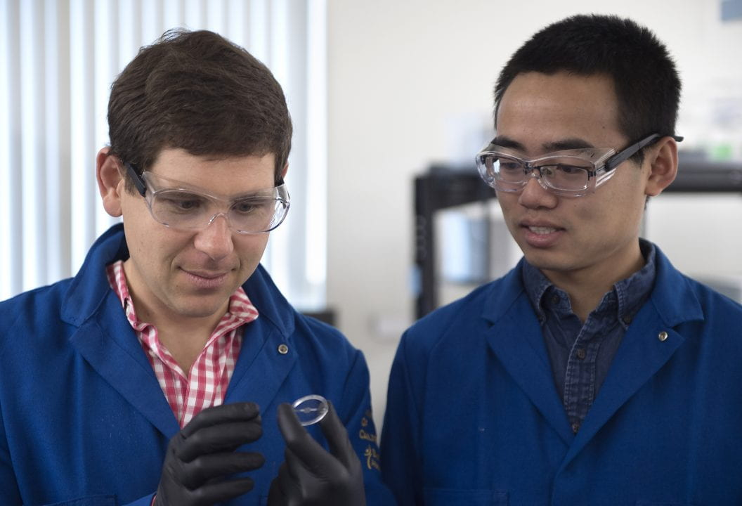 Associate Professor of Chemical Engineering & Materials Science Alon Gorodetsky and grad student Chengyi X