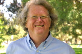 Todd Holmes receives UCI's first Maximizing Investigators' Research Award from the NIH
