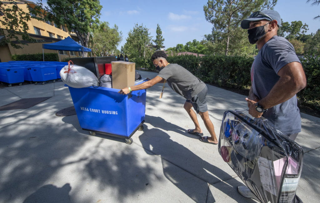Eric Parker sr. helps Education major Eric Parker Jr. move belongings to his dorm room in Mesa court.