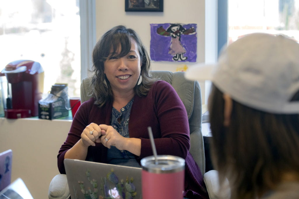 Literary journalism associate professor Erika Hayasaki works with students in her office