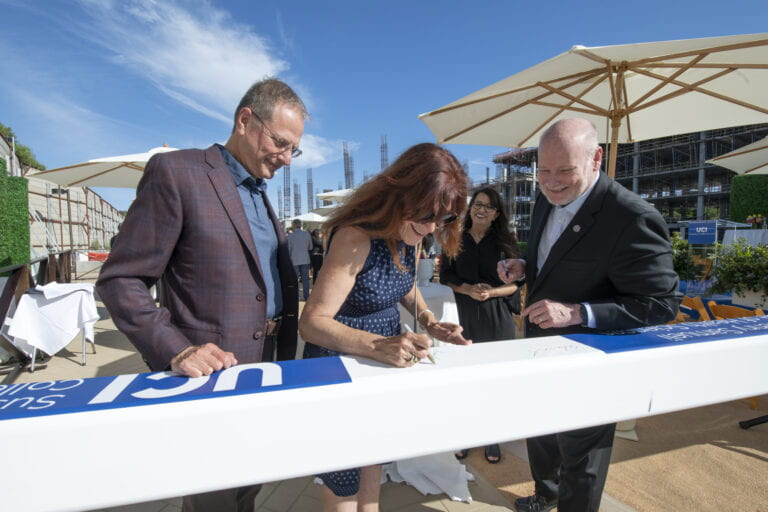 UCI hosts topping-out ceremony for Susan & Henry Samueli College of Health Sciences