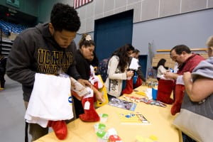Anthony Poullard, a graduate student in education, stuffs stockings after the Fifty for 50 spirit rally for children served through the Olive Crest organization. Steve Zylius / UC Irvine