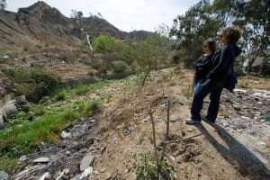 Reyes (right) and UCI doctoral student Kristen Goodrich examine a severely eroded and flood-damaged canyon area in Tijuana, Mexico, as part of the FloodRISE project. Steve Zylius / UC Irvine