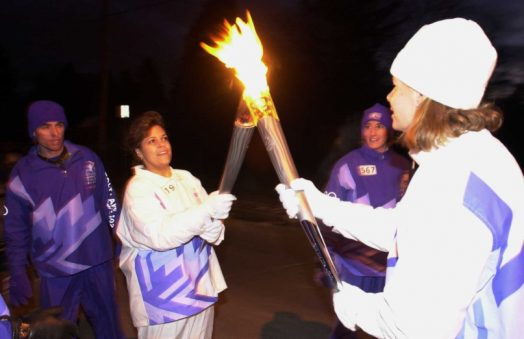 Mariana Lebron carrying the 2002 Olympic torch